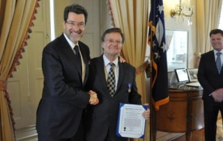 U.S. Ambassador to the Czech Republic, Norman Eisen, presents Dr. Losiewicz the Civilian Meritorious Service Medal in Prague.